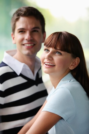 south eastern european descent: Man and woman looking up and smiling