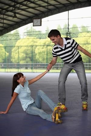 people helping people: Man helping woman up