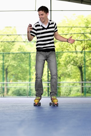 Man listening to portable MP3 player while roller skating Stock Photo - 8148492