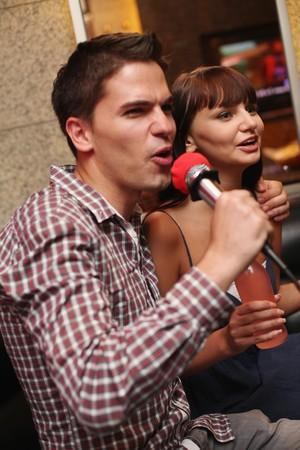Man and woman at karaoke bar Stock Photo - 8148924