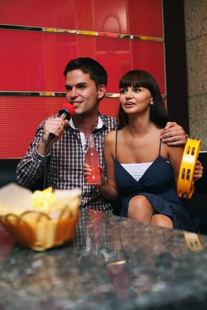 Man and woman at karaoke bar Stock Photo - 8148814