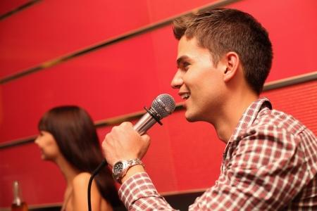 Man and woman at karaoke bar photo