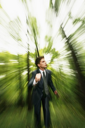 south western european descent: Businessman running in the forest