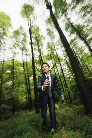 Businessman running in the forest photo