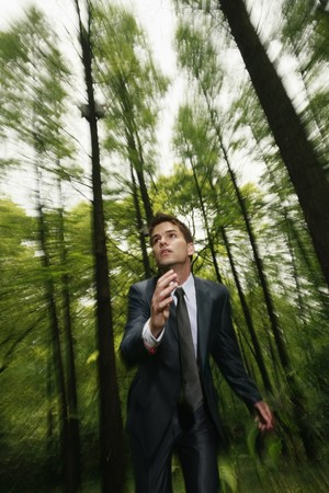 Businessman running in the forest Stock Photo - 8149397