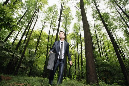 south western european descent: Businessman in the forest Stock Photo