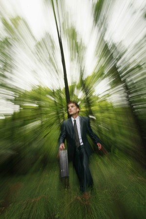 Businessman in the forest Stock Photo - 8149122