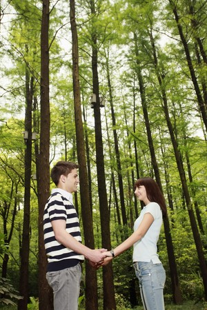 Man and woman holding hands in the forest Stock Photo - 8149408