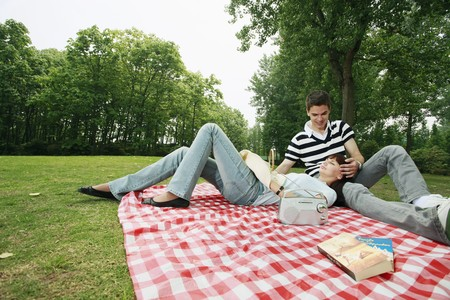 Man and woman having a picnic Stock Photo - 8149436