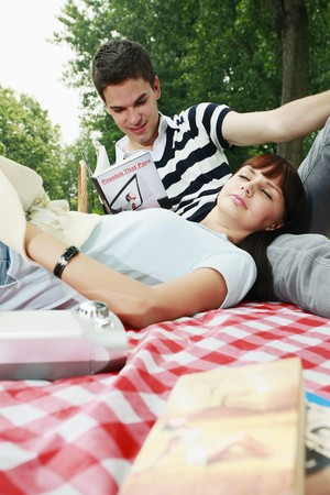 Man and woman having a picnic Stock Photo - 8148858