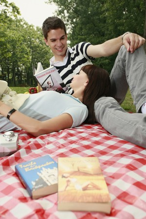 Man and woman having a picnic Stock Photo - 8149161