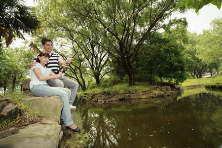 south eastern european descent: Man and woman fishing together Stock Photo
