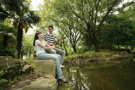 Man and woman fishing together Stock Photo - 8149465