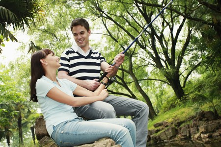 man fishing: Man and woman fishing together Stock Photo