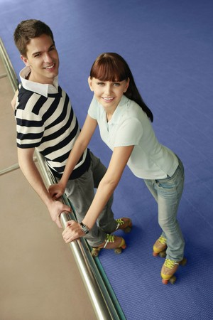 south western european descent: Man and woman at the skating rink