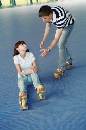 Man offering to help woman up Stock Photo - 8149398