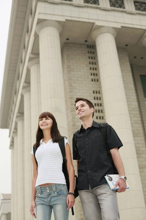 south eastern european descent: Man and woman with backpacks looking away