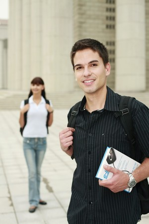 south eastern european descent: Man with backpack and book