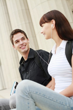 Man and woman sharing a portable MP3 player photo