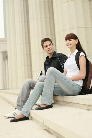 Man and woman sharing a portable MP3 player Stock Photo - 8149043