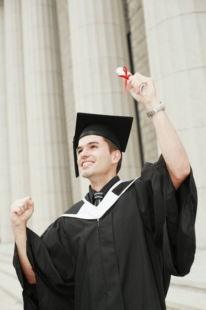 Graduate holding up his scroll photo