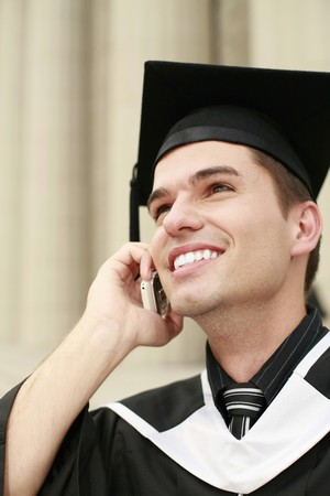 Graduate talking on the phone photo