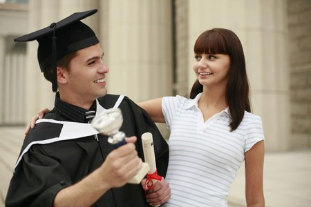 Graduate and woman looking at each other Stock Photo - 8148632