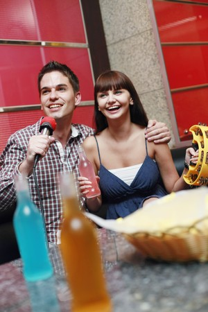 Man and woman at karaoke bar photo