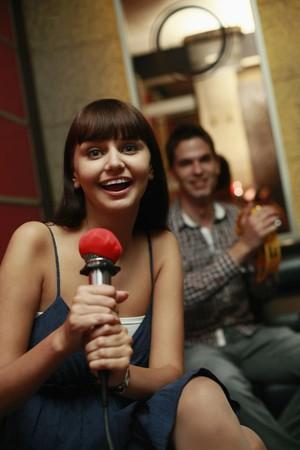 Woman singing in karaoke bar Stock Photo - 8148708