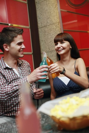 south eastern european descent: Man and woman toasting drinks