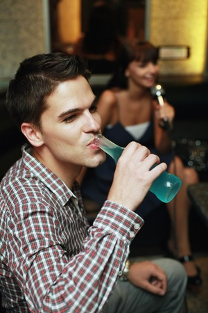south eastern european descent: Man enjoying his bottled drink Stock Photo
