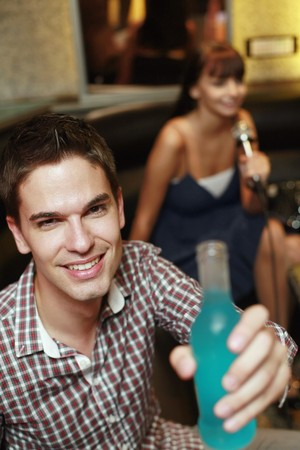 Man with a bottle of drink photo