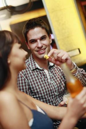 south eastern european descent: Man and woman at karaoke bar