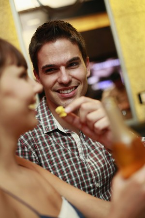 south western european descent: Man and woman at karaoke bar