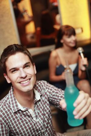 south western european descent: Man holding bottled drink
