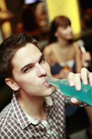 south eastern european descent: Man drinking bottled drink Stock Photo