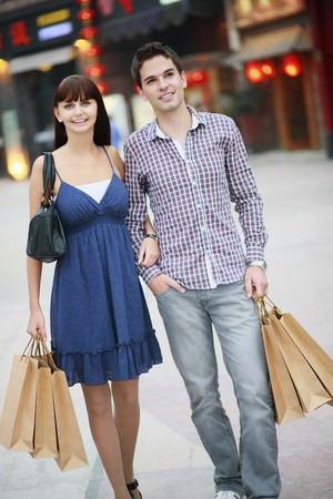 Man and woman with shopping bags Stock Photo - 8149257