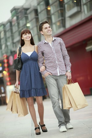 weekend activities: Man and woman with shopping bags