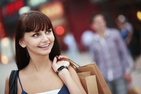 south eastern european descent: Woman with shopping bags