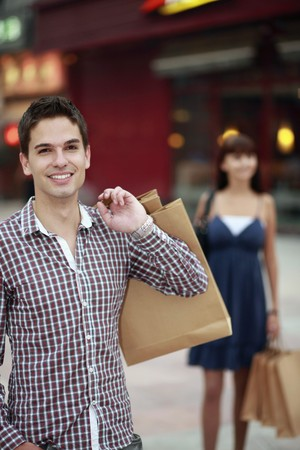 south eastern european descent: Man with shopping bags smiling Stock Photo