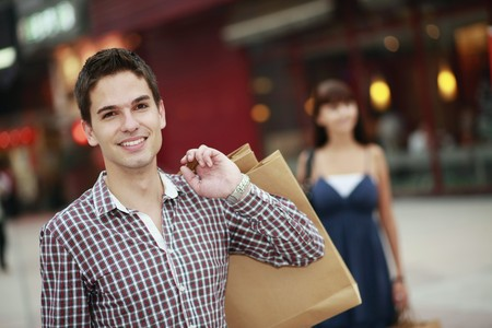 Man with shopping bags smiling Stock Photo - 8149311