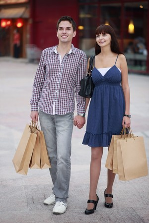 south eastern european descent: Man and woman with shopping bags