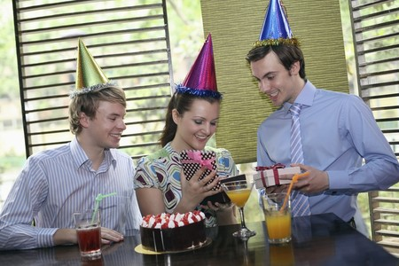 Business people celebrating colleagues birthday photo