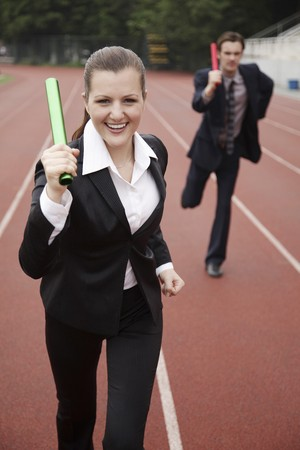 relay baton: Business people running in a relay Stock Photo