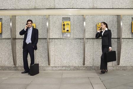Business people using public telephones Stock Photo - 8149445