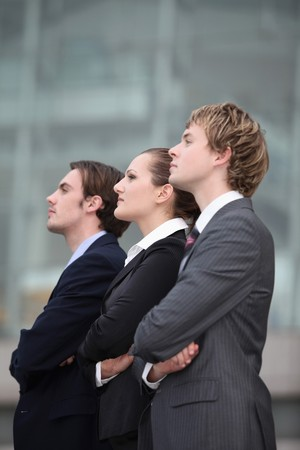 Business people standing with arms crossed photo