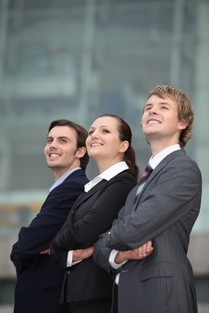 corporate image: Business people standing with arms crossed