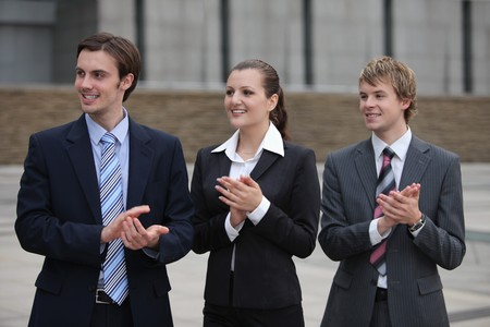 Business people clapping hands Stock Photo - 8148354