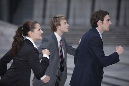 personas corriendo: Gente de negocios que se ejecuta  Foto de archivo