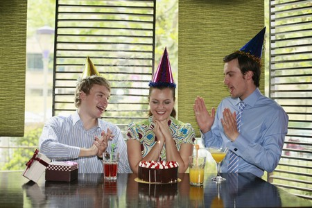 Business people celebrating colleague's birthday Stock Photo - 8149373